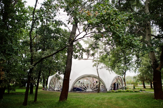 Beautiful wedding set decoration on outdoor tent in park.