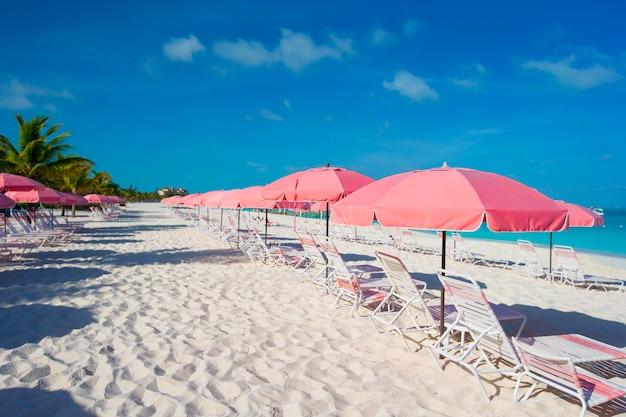 Beautiful white beach with sun loungers