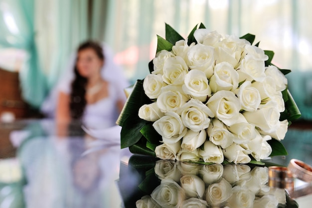 Beautiful white bridal wedding bouquet on the table