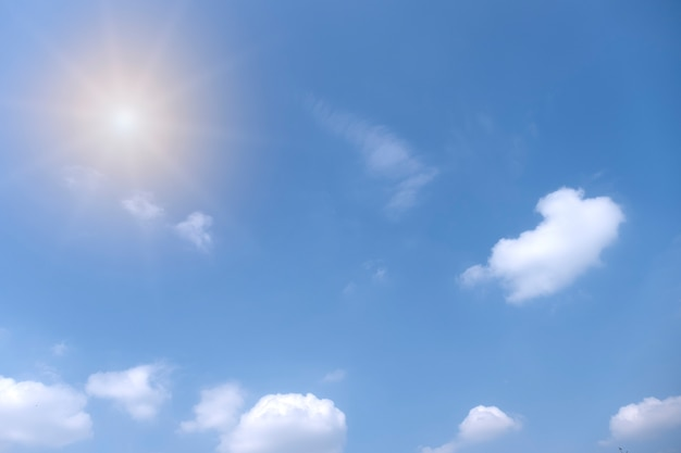 Beautiful white clouds with sun on blue sky.