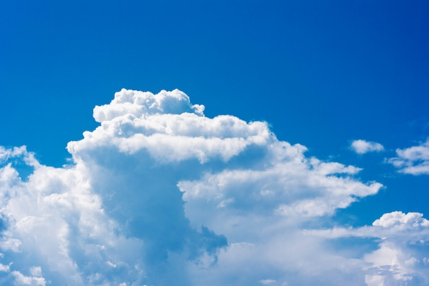 Beautiful white cumulonimbus clouds against the background of the bright blue sky