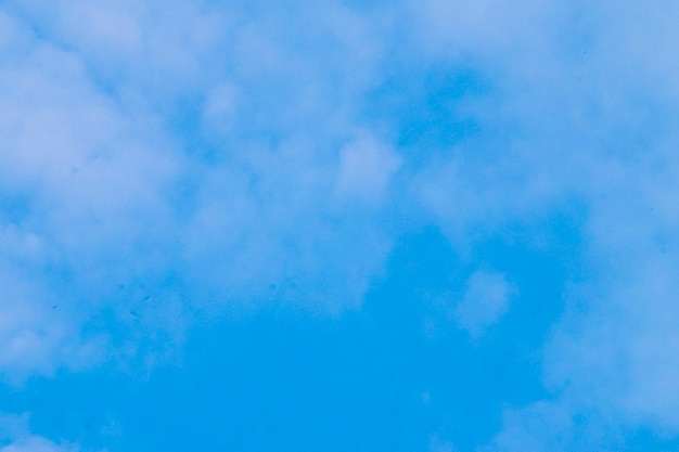 Beautiful white fluffy and cirrocumulus clouds on a blue sky background
