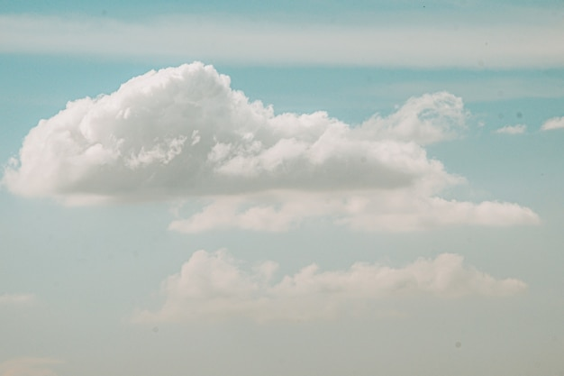 Beautiful white fluffy clouds sky background