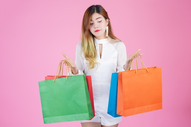 Beautiful white girl holding a shopping bag, fashion and beauty