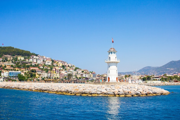 Beautiful white lighthouse in alanya town in turkey