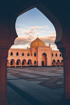 Beautiful white mosque in the sunset light. view through the arch. bolghar, rusiia.
