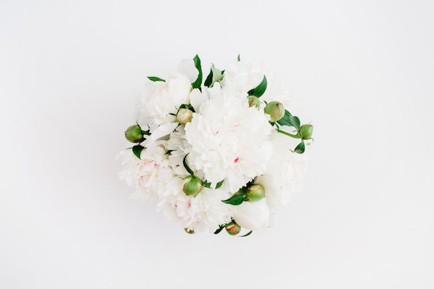 Beautiful white peonies flowers bouquet on white background. flat lay, top view