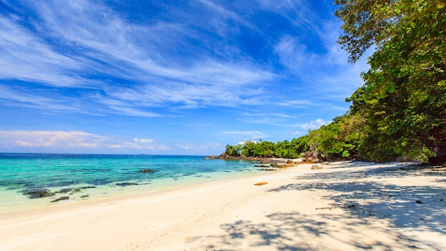 Beautiful white sand tropical beack with blue sea and sky