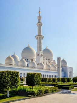 Beautiful white tower of the mosque against the sky in the sunlight. the famous sheikh zayed grand mosque.