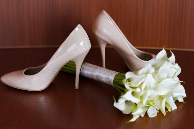 Beautiful white wedding bouquet of lilies lies