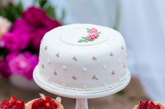Beautiful white wedding cake with flowers