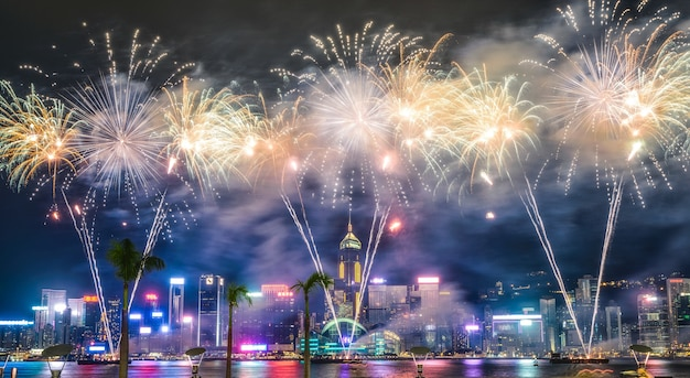 Beautiful wide shot of breathtaking fireworks in the night sky during holidays over the city
