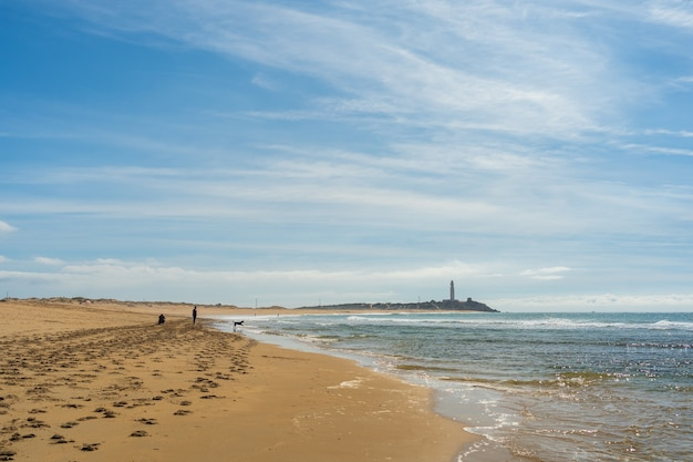 Beautiful wide shot of a sandy beach in zahora spain with a clear blue sky
