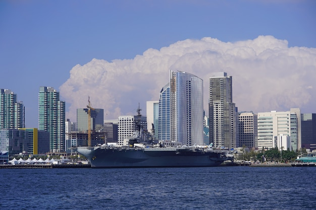 Beautiful wide shot of the skyline of san diego downtown with amazing large clouds