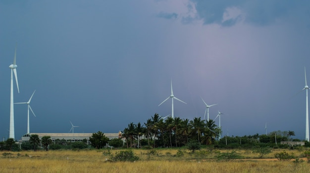Beautiful wind farm in the barren land with thunder rumbles inside the clouds