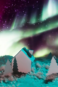 Beautiful winter concept with aurora borealis