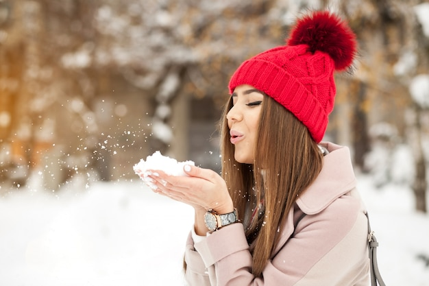 Beautiful winter fashion snow young