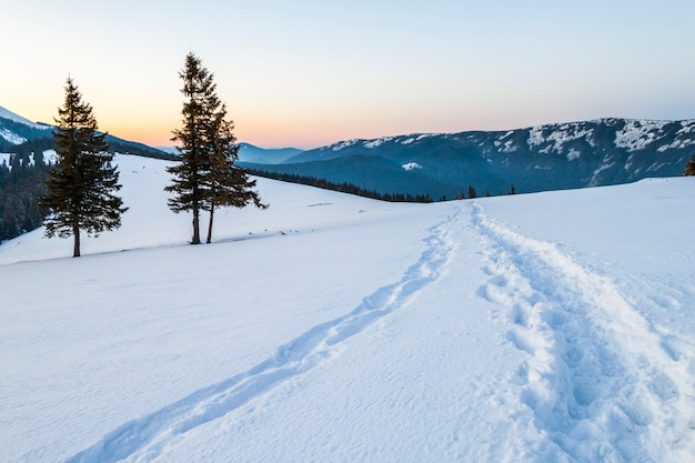 Beautiful winter landscape in the mountains with snow path in steppe