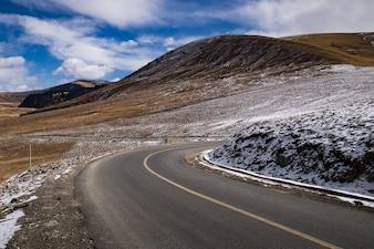 Beautiful winter road in tibet with blue sky