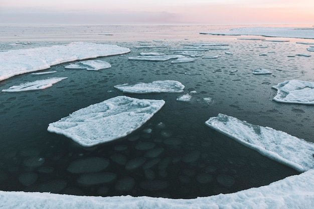 Beautiful winter sea landscape with floating ice fragments