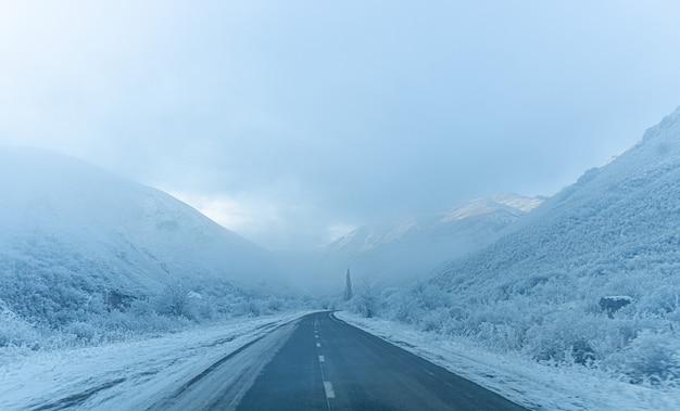 Beautiful winter snowy mountain road