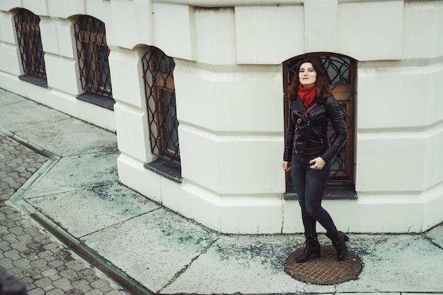 Beautiful woman against white vintage building