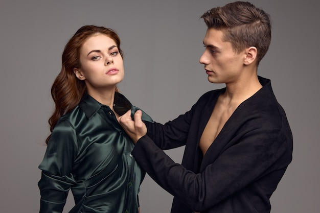 Beautiful woman and aggressive man in a suit