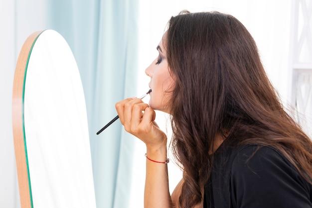Beautiful woman applying halloween make-up