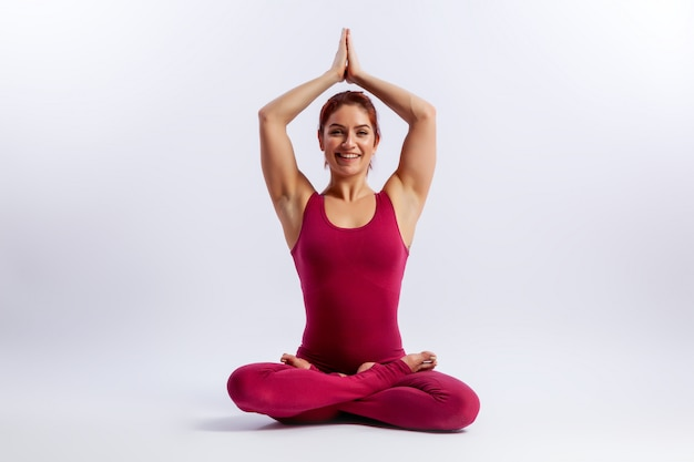 Beautiful woman in an asana pose