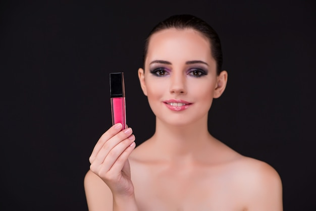 Beautiful woman in beauty concept with lipstick