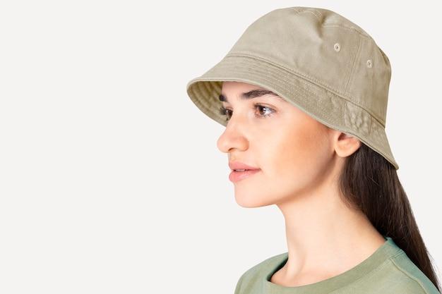 Beautiful woman in beige bucket hat fashion studio shoot