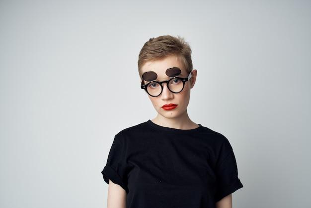 Beautiful woman in a black t-shirt fashion street style. high quality photo
