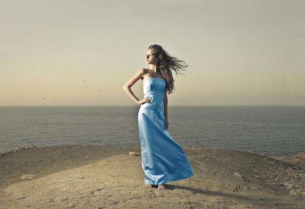 Beautiful woman in a blue dress