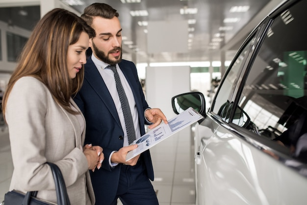 Beautiful woman buying new car