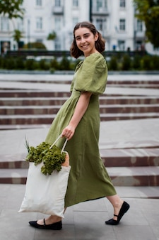 Beautiful woman carrying organic groceries