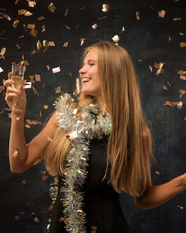 Beautiful woman celebrating new year concept