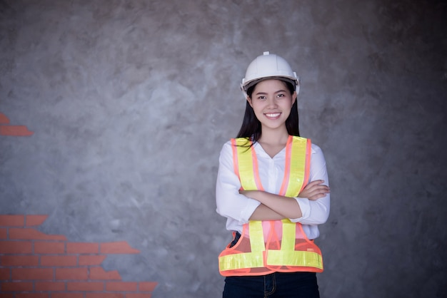 Beautiful woman civil engineer portrait with protect helmet.