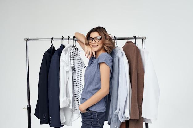 Beautiful woman clothes hanger shopping studio emotion. high quality photo