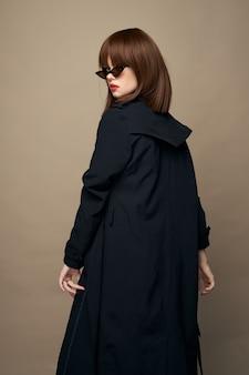 Beautiful woman coat with belt elegant style
