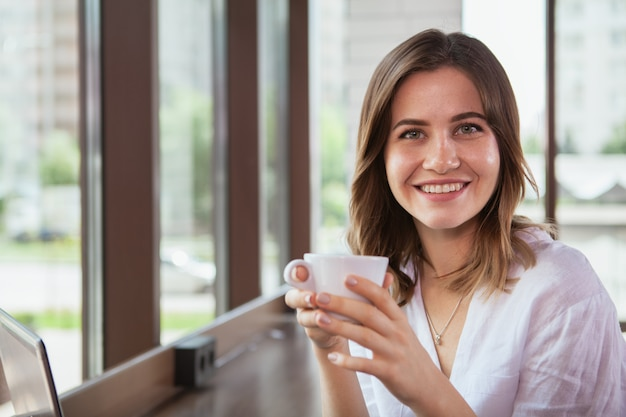 Beautiful woman at the coffee shop