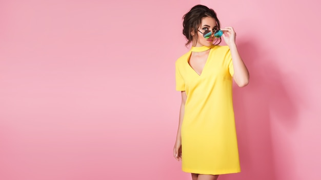 Beautiful woman in colorful clothes wearing sunglasses