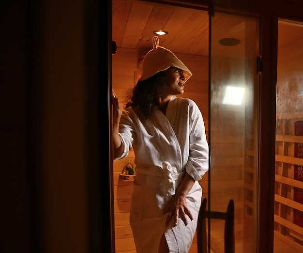 Beautiful woman coming out of the sauna. spa resort