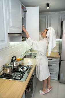Beautiful woman cooking in modern kitchen. healthy food. diet concept