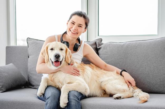Beautiful woman cuddling nice dog