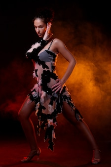 Beautiful woman dancin latin dance
