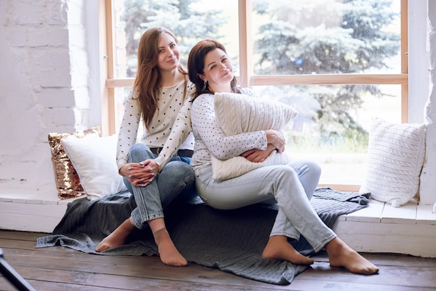 Beautiful woman and daughter on the sofa