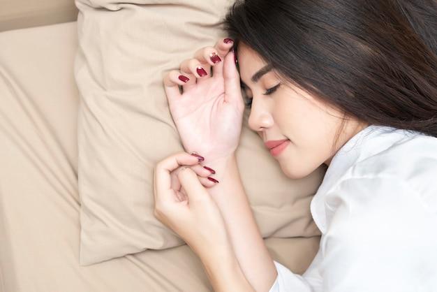 Beautiful woman deep sleeping on her bed.