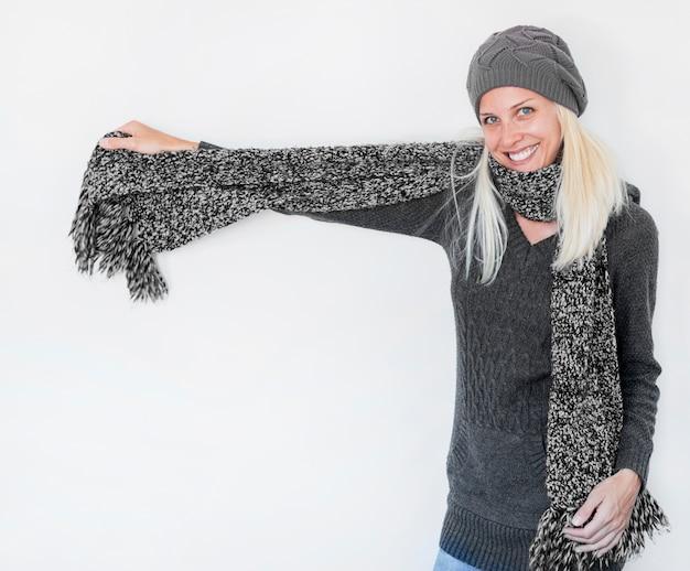 Beautiful woman demonstrating warm scarf