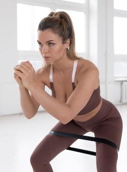 Beautiful woman doing calisthenics concept