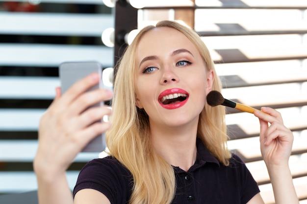 Beautiful woman doing evening makeup